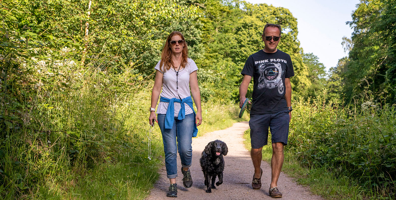 Couple and dog walking in Wellesley Woodlands